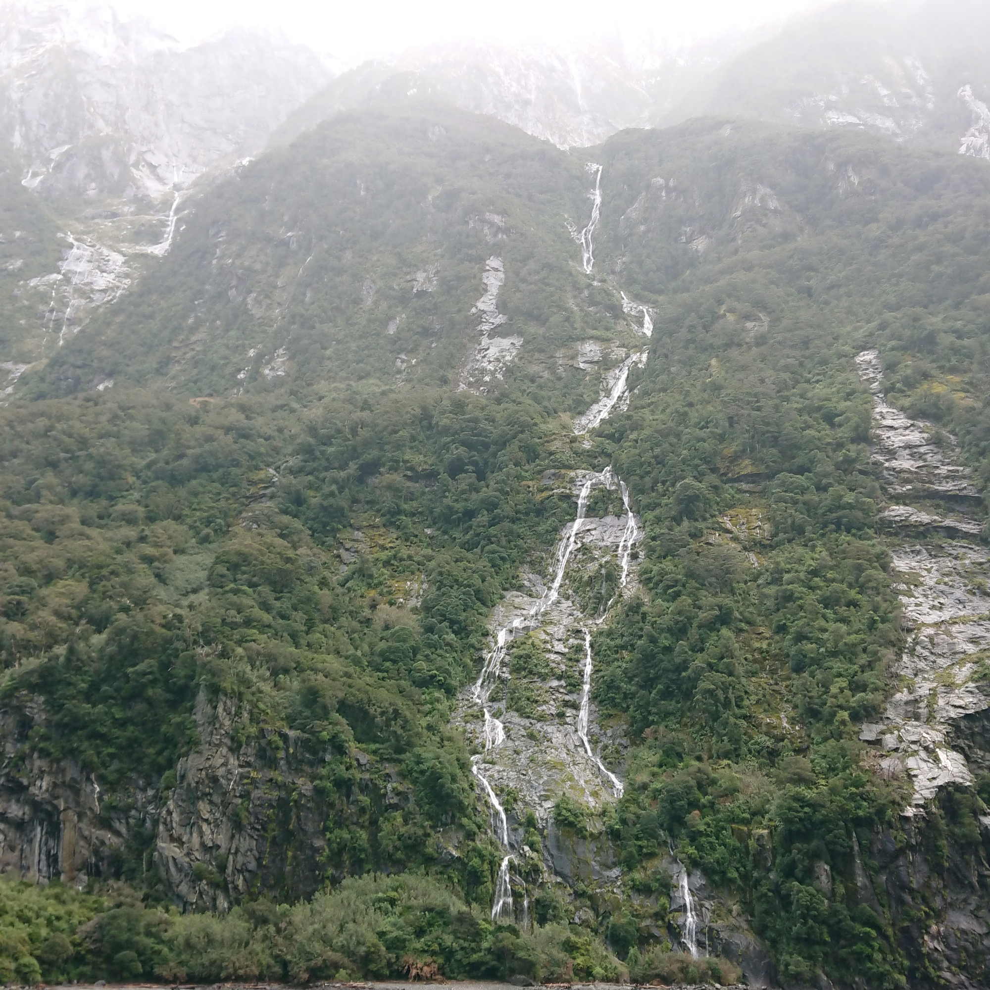 Looking up the waterfalls at Milford Sound
