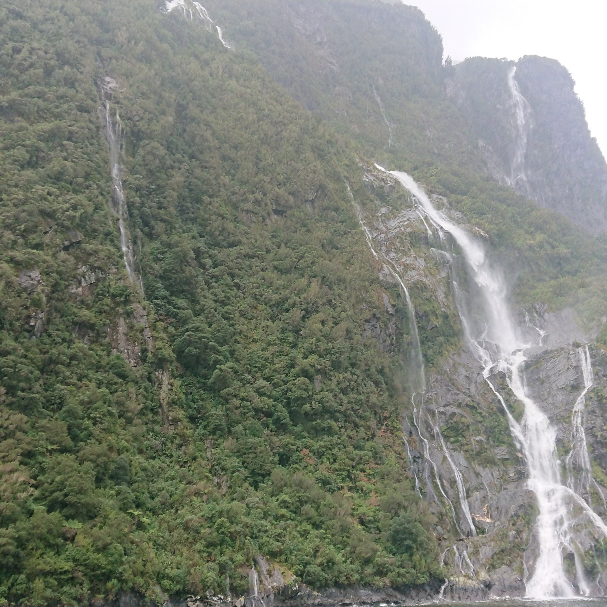 Tumbling waterfalls add plenty of atmosphere in Milford Sound
