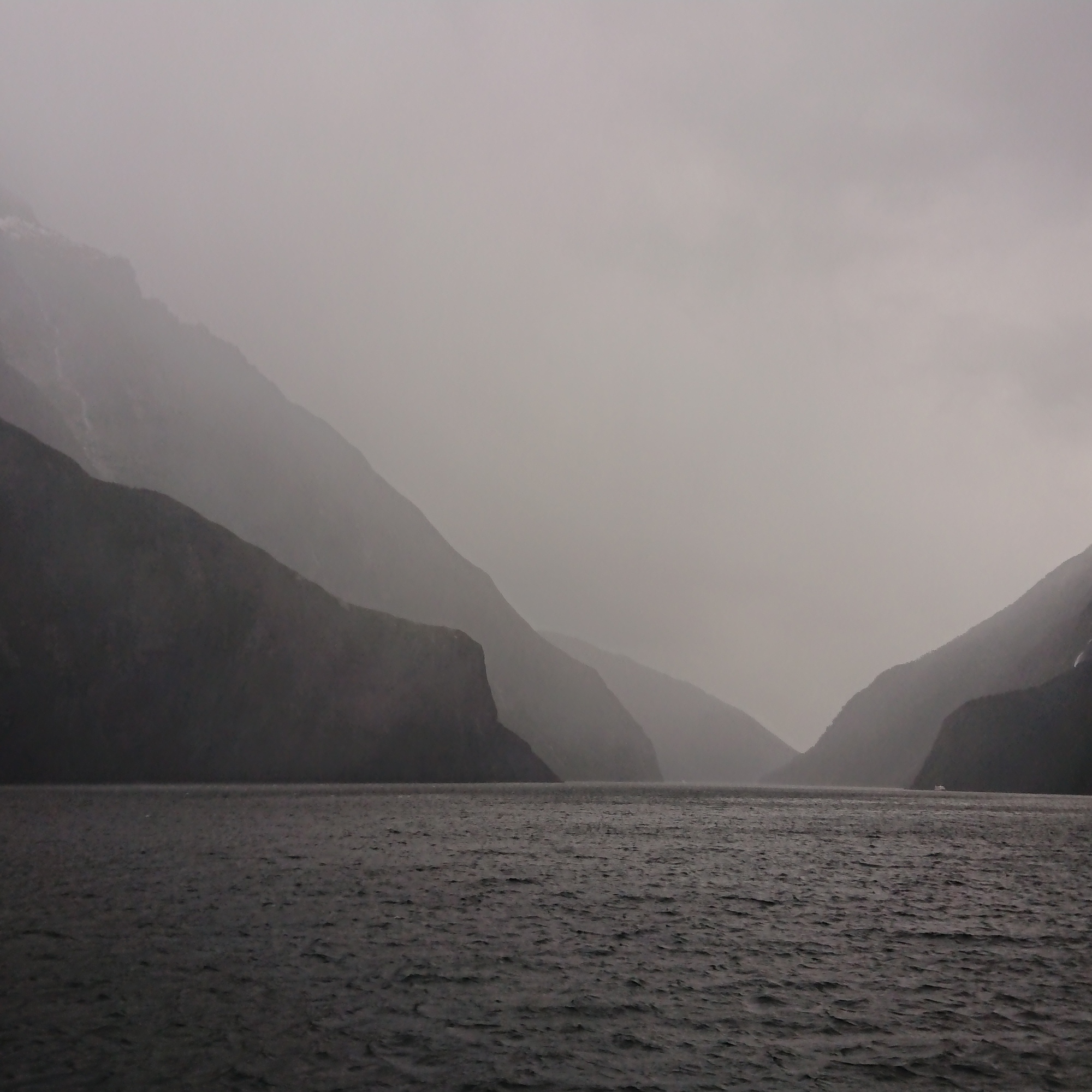 The light dims slightly and creates a different mood in Milford Sound