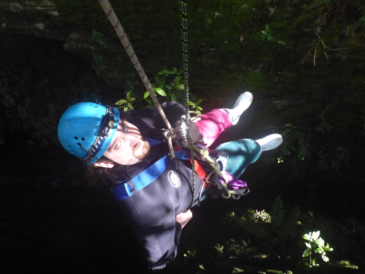Abseiling 27ft down into the caves