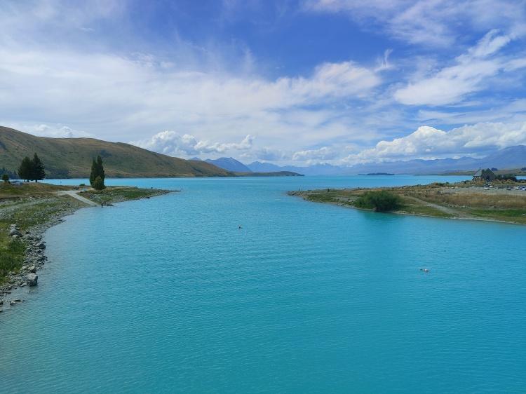 Lake Tekapo, as seen from the pedestrian bridge leading into town