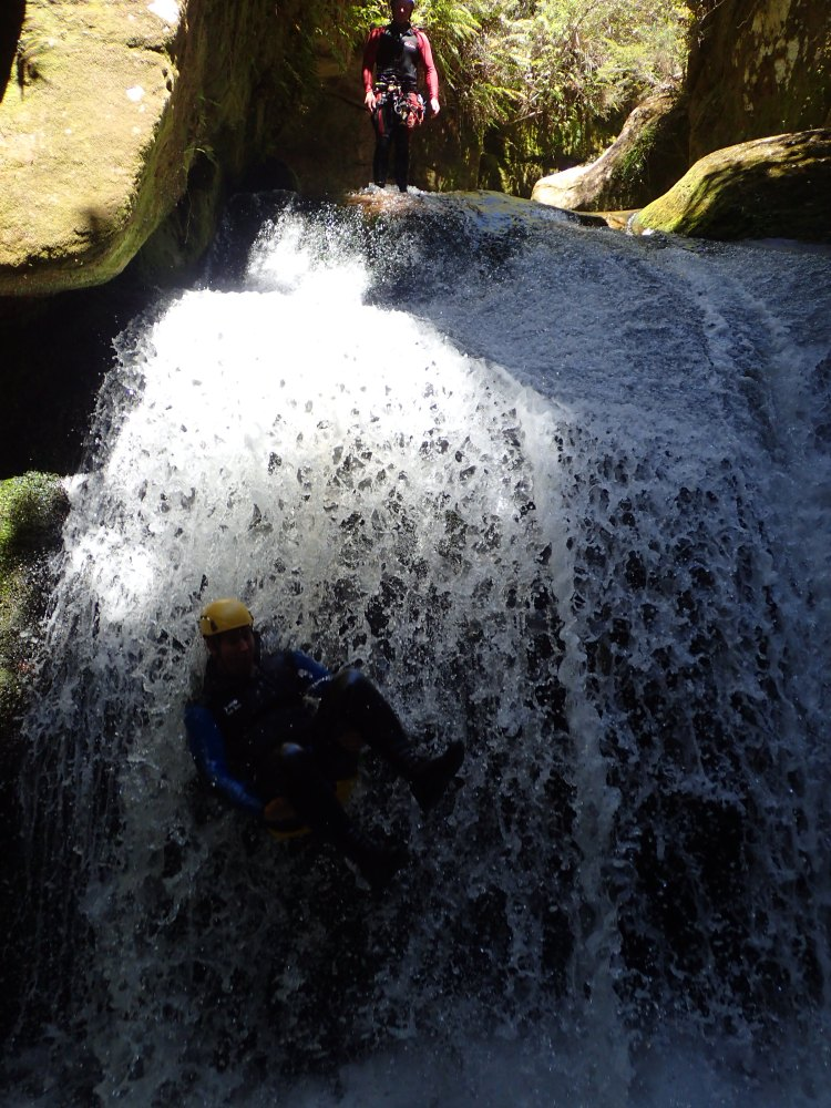 Casually falling down a waterfall after a slide