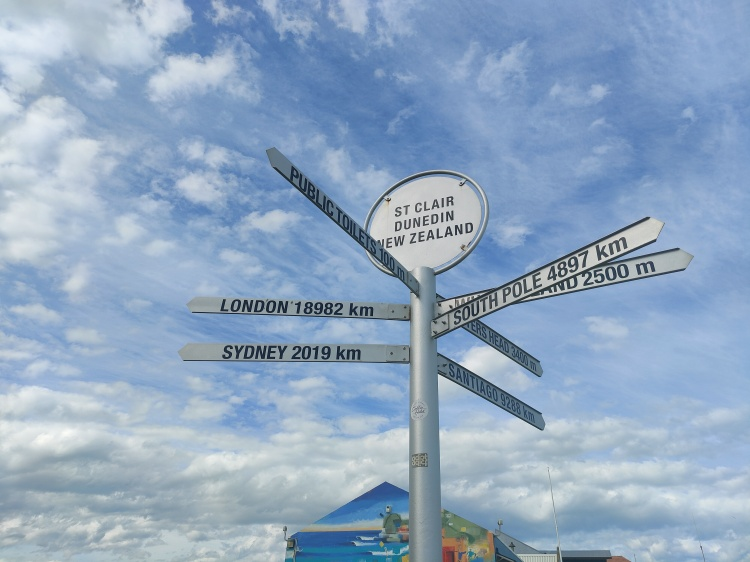 A sign in St Clair, Dunedin, showing distances to major cities around the world