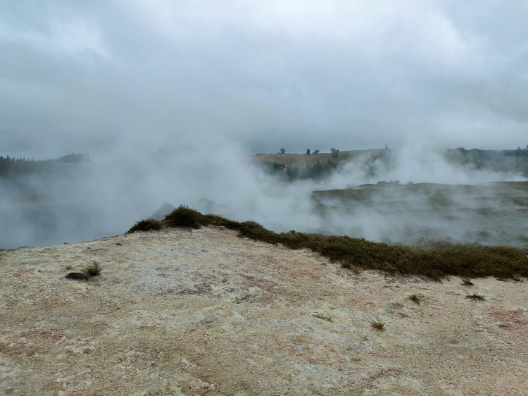 Steam escapes from behind the ridge at Craters of the Moon